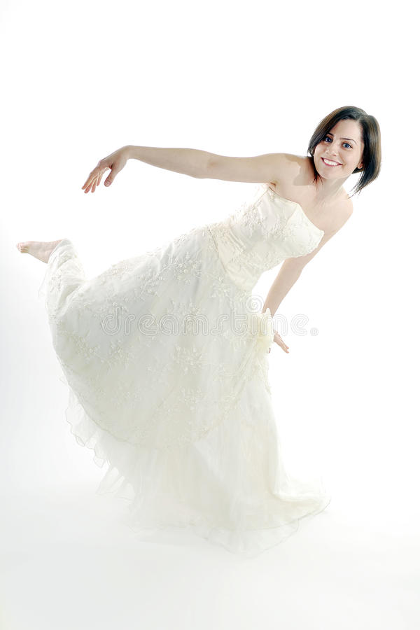 Download Cute Bride Posing In An Unusual Position Stock Image - Image: 14862557
