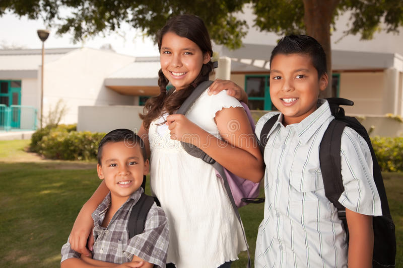 Cute Brothers and Sister Ready for School. Cute Brothers and Sister Wearing Backpacks Ready for School royalty free stock photography