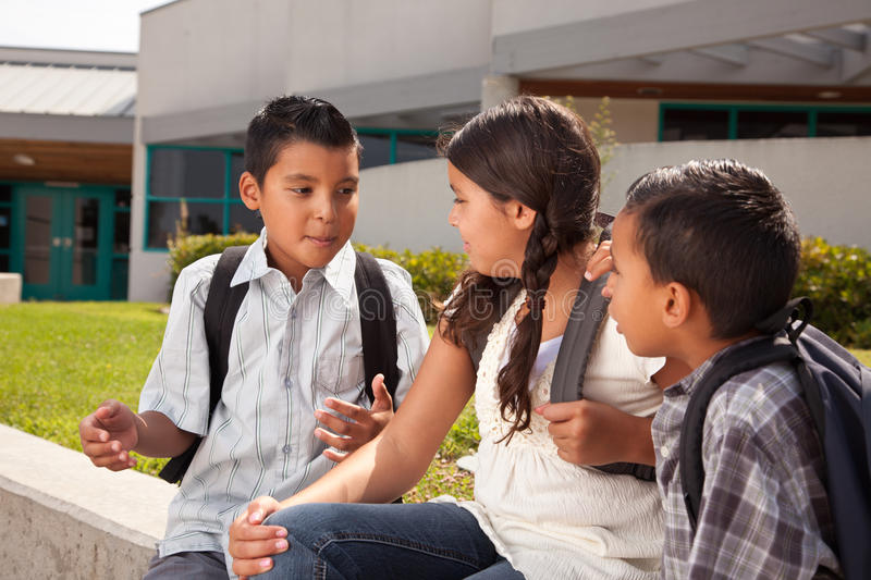 Cute Brothers and Sister Talking, Ready for School stock photo