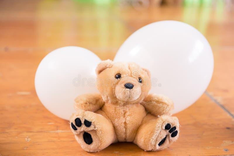 Brown Teddy Bear and White Balloons Birthday Decoration stock photos