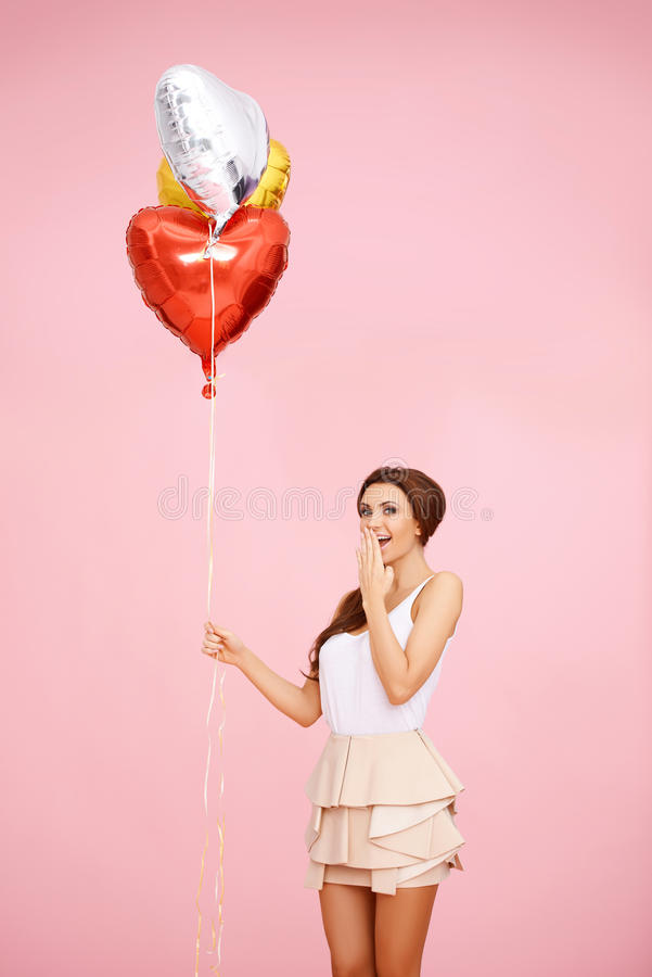 Cute Brunette With Balloons Stock Photo