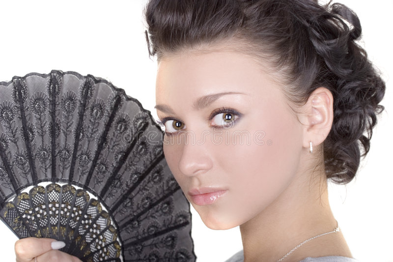 Cute Brunette With Fan. Beautiful lady with fan over white stock photos