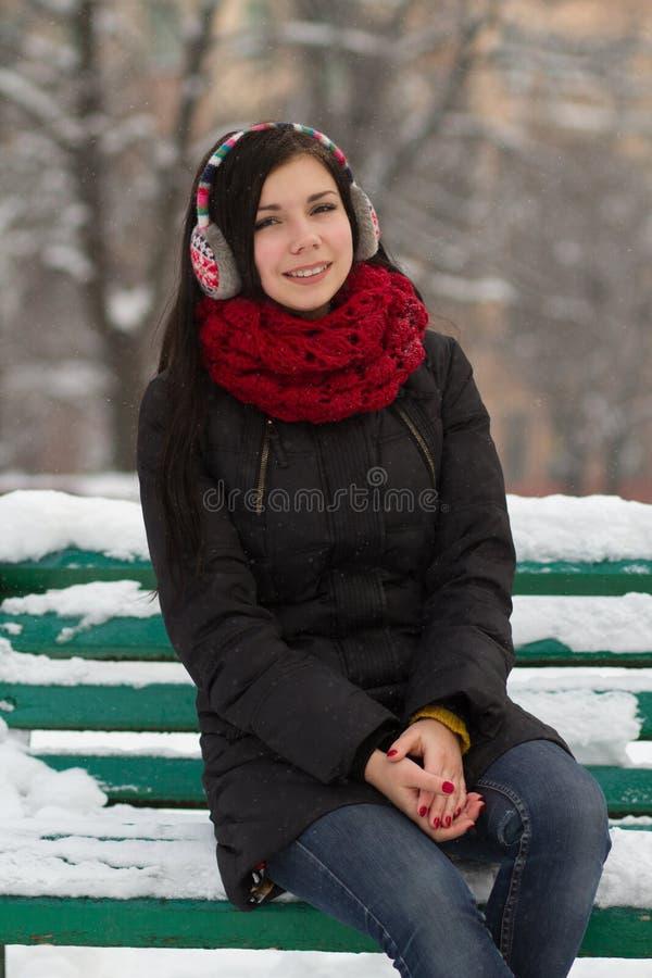 Cute brunette girl on snow stock images