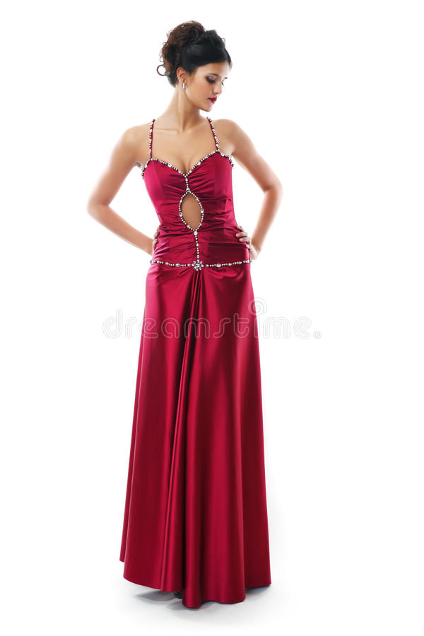 Cute brunette in a red dress stock photos