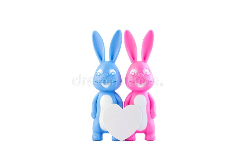 Cute bunnies happy lovers couple with heart on white background isolated, creative Valentine's day card. Minimal style. Cute bunnies as happy lovers couple stock photo