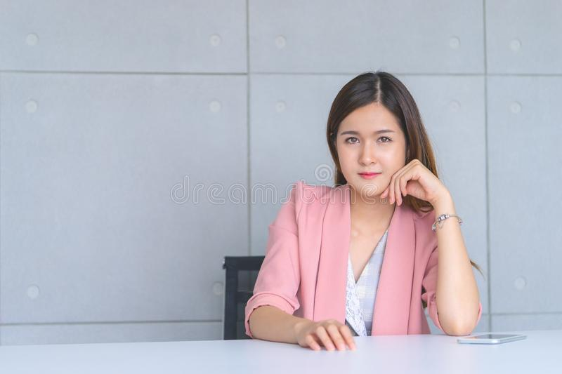 Female business office worker portrait in meeting room stock photo