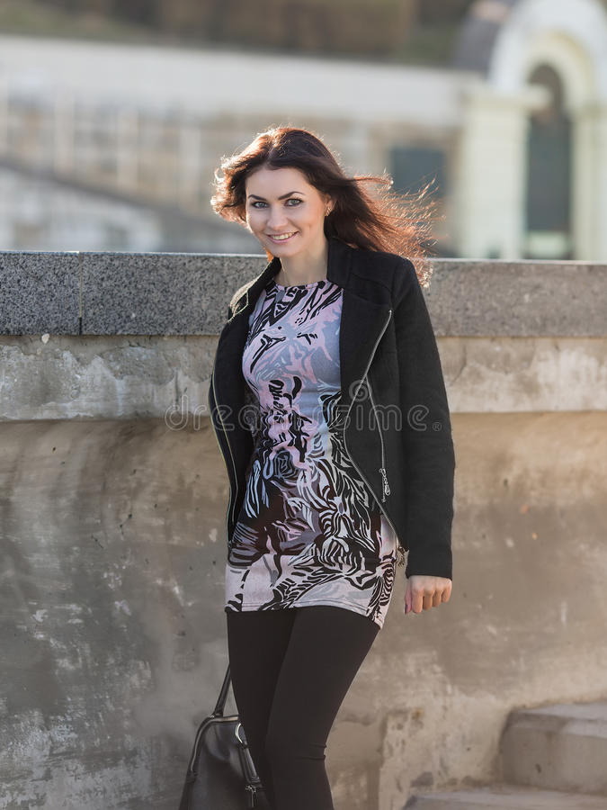 Cute business woman walks outside royalty free stock images