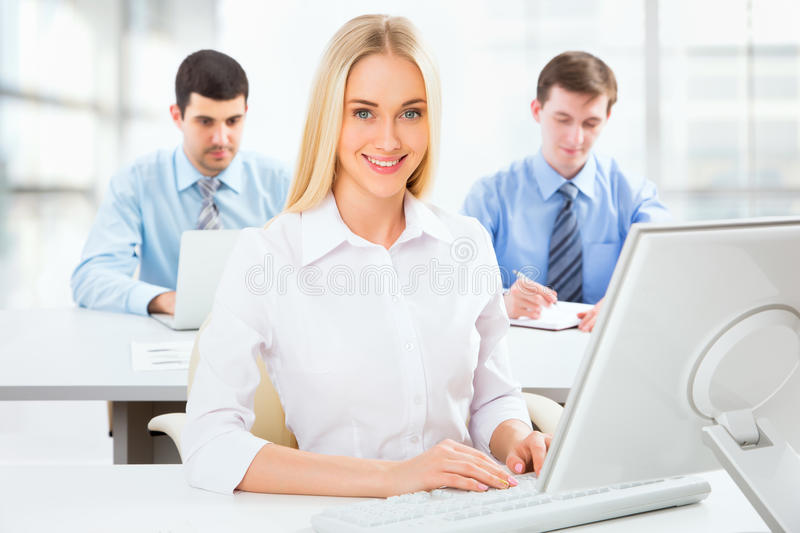 Cute businesswoman in an office stock image
