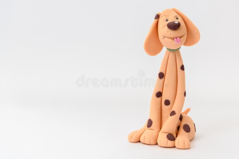 Cute cartoon character dog made from icing. And isolated on a white background stock photo