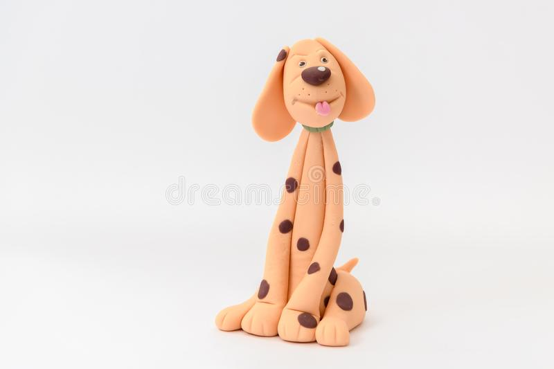 Cute cartoon character dog made from icing. And isolated on a white background stock images