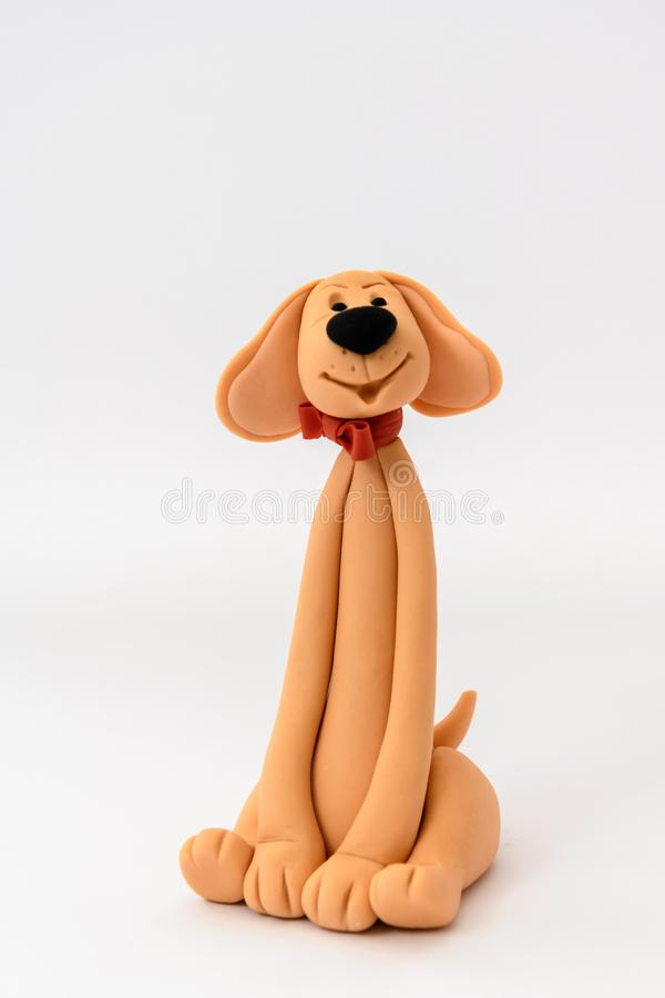 Cute cartoon character dog made from icing. And isolated on a white background royalty free stock photos