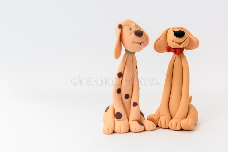Cute cartoon character dogs made from icing. And isolated on a white background royalty free stock photography