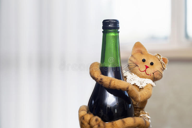 Cute cat doll on a drink bottle stock photo
