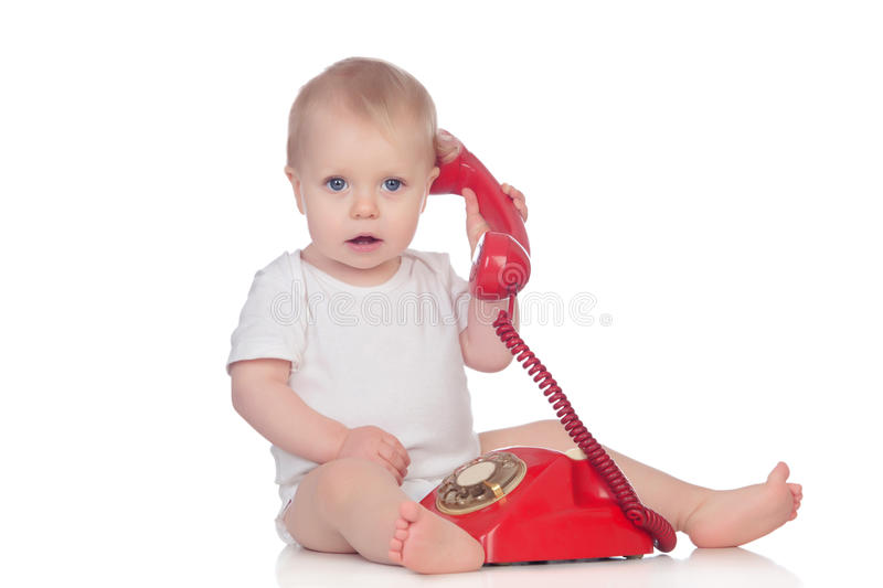 Cute caucasian baby playing with telephone royalty free stock photo