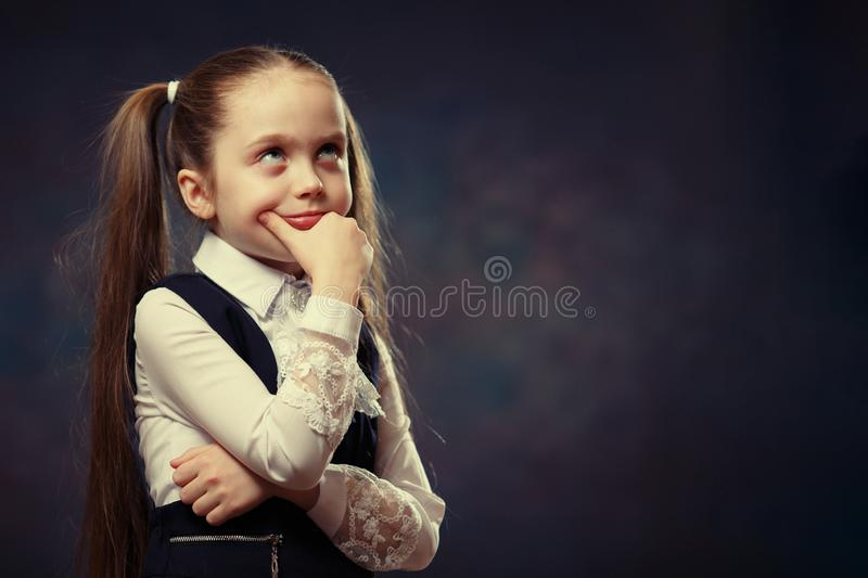 Cute Caucasian Elementary Schoolgirl Body Portrait. Color Tone stock photo