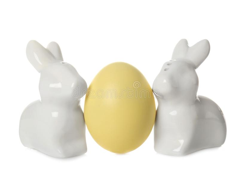 Cute ceramic Easter bunnies and dyed egg stock photos