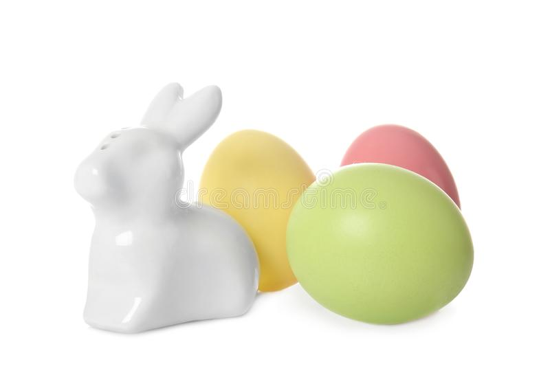 Cute ceramic Easter bunny and dyed eggs stock photo