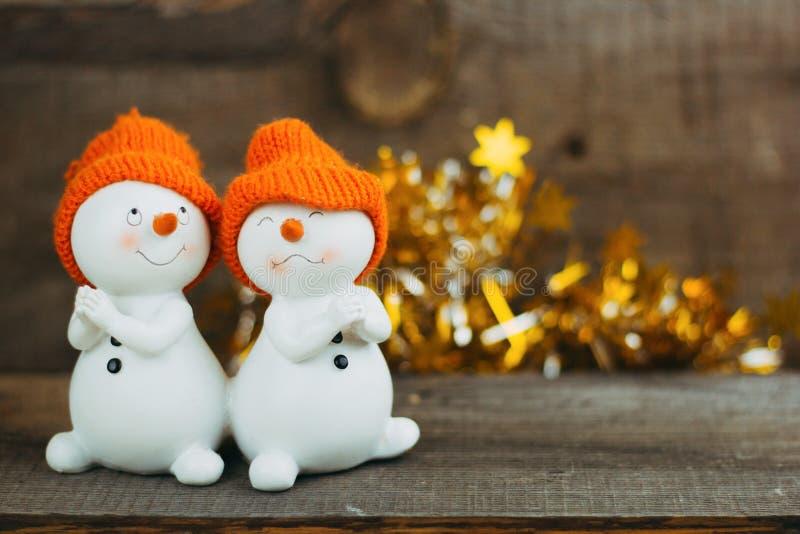 Cute ceramic toy pair snowmen royalty free stock image