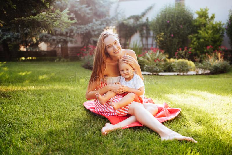 Cute cheerful child with mother royalty free stock photography