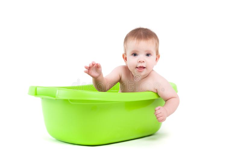 Cute cheerful little boy in green tub royalty free stock image