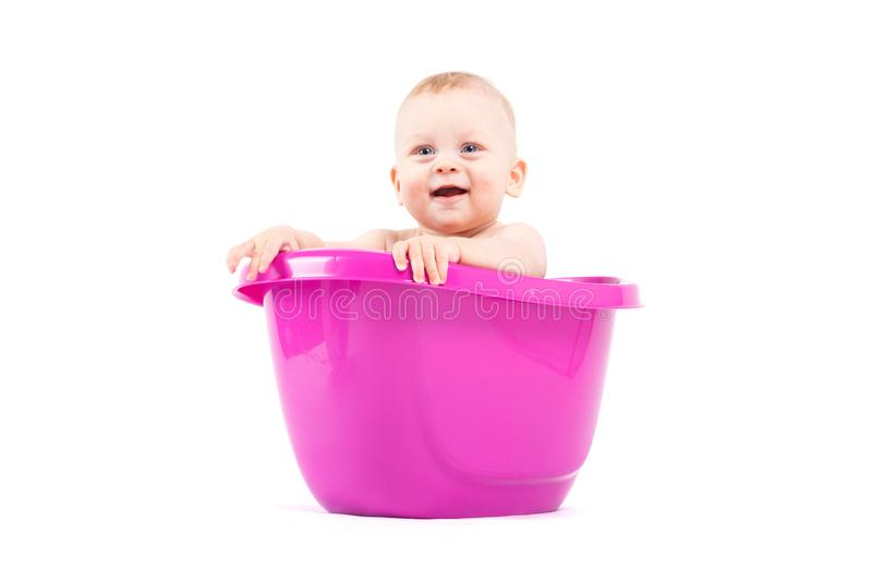 Cute cheerful little boy in purple tub royalty free stock images