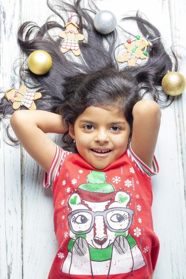 Cute cheerful smiling girl with decorated Christmas hair royalty free stock photography