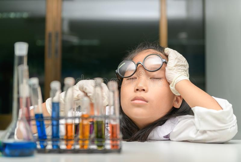 Cute chemistry students sleeping after doing science experiment royalty free stock photo