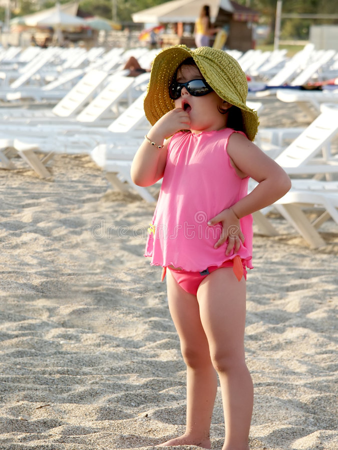 Cute child on Antalya beach royalty free stock images