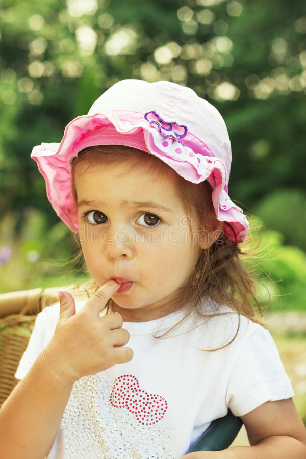 Cute child with big clear eyes impressively looking at the camera. stock photos