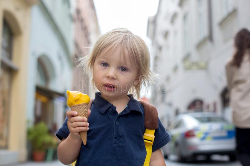Cute child, boy, visiting Prague after the quarantine Covid 19, eating ice cream stock photos
