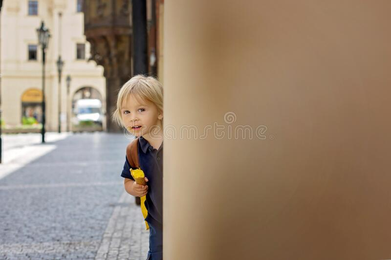Cute child, boy, visiting Prague after the quarantine Covid 19, eating ice cream stock image