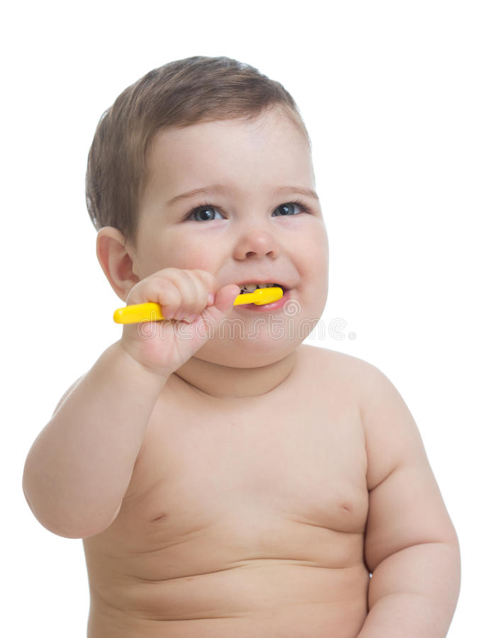 Cute child brushing teeth and smile, isolated over white. stock images