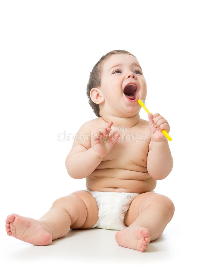 Cute child brushing teeth and smile, isolated over white. royalty free stock images