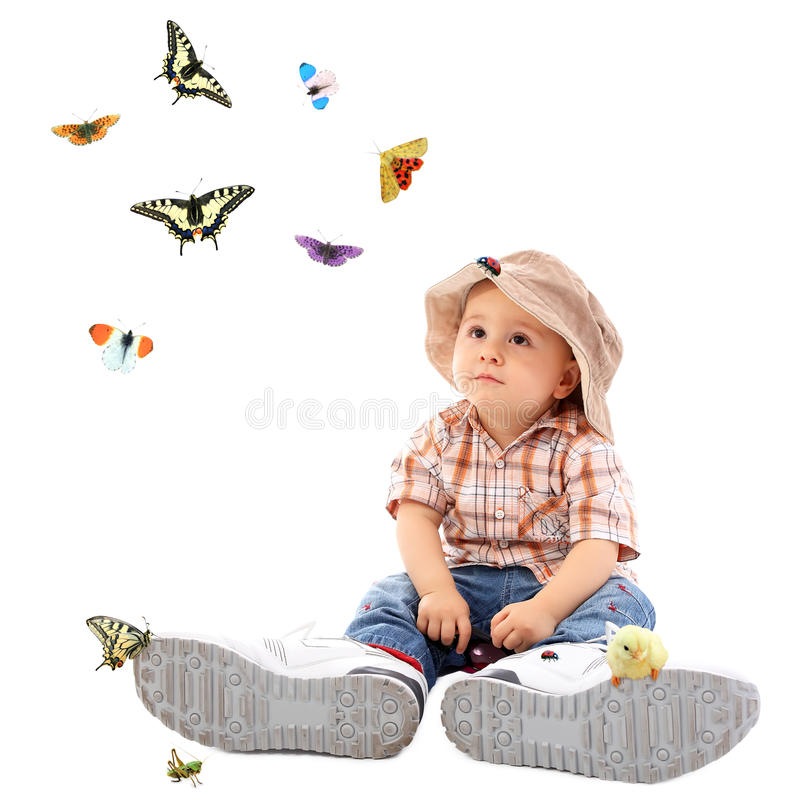 Download Cute child with butterfly stock photo. Image of feet - 18406702