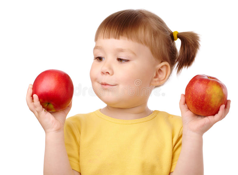 Cute child choose between two apples royalty free stock photo