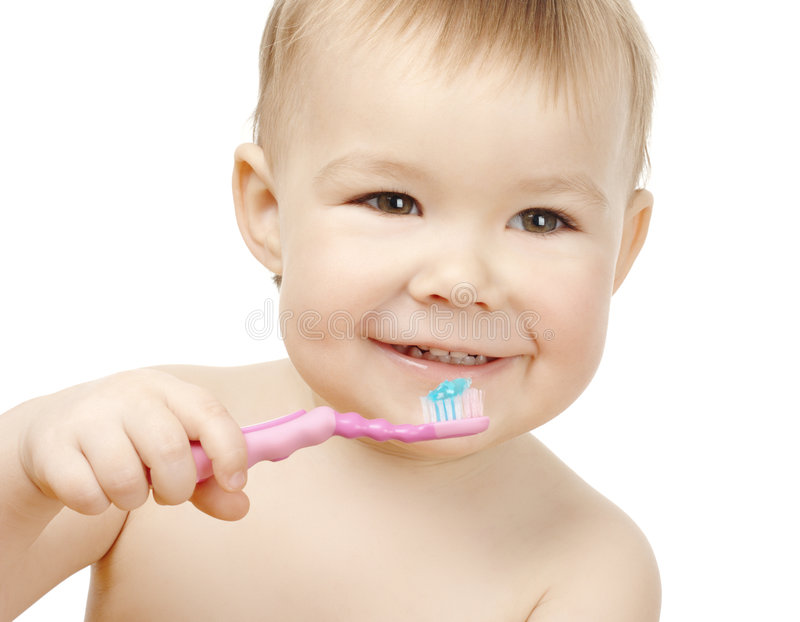 Cute child cleaning teeth and smile stock image