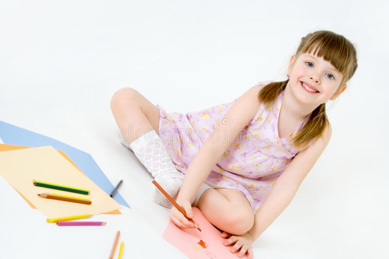 Download Cute Child Draw With Colorful Crayons And Smile Stock Photo - Image: 24997012