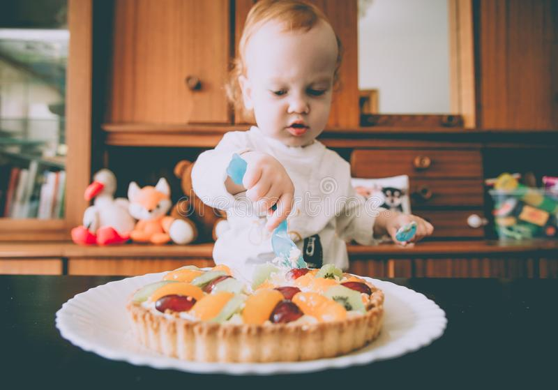 Cute child eating his birthday cake stock photos
