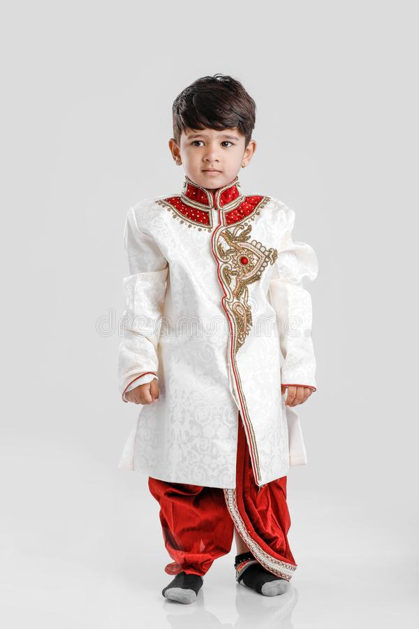 Cute Child in ethnic wear and giving multiple expression stock images