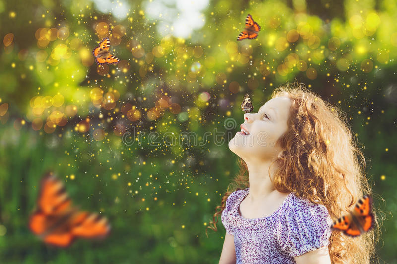 Cute child girl with a butterfly on his nose stock image
