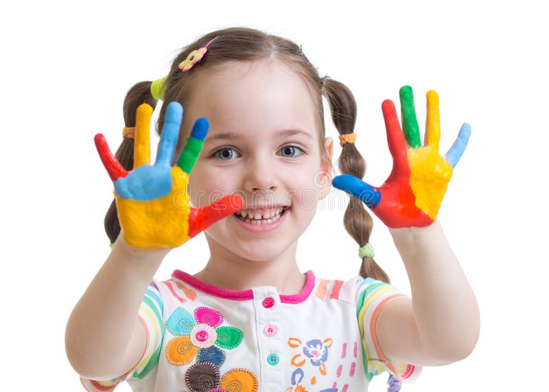 Cute child girl have fun coloring her hands royalty free stock photography