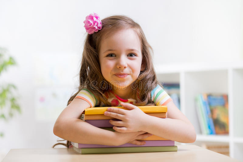 Cute child girl preschooler with books stock images