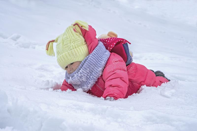 Cute child girl on snow. Winter outdoor activities. Cute child baby on snow. Winter outdoor activities royalty free stock photo