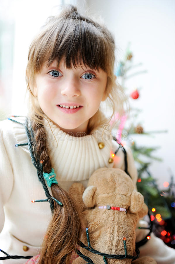 Cute child girl waiting for Christmas eve stock photo