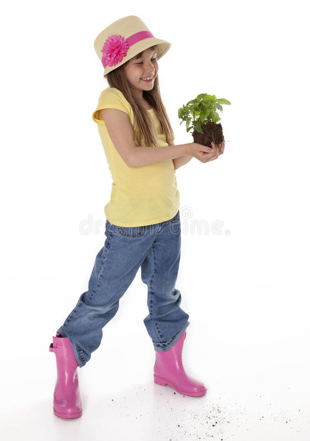 Cute Child Holding Plant stock images