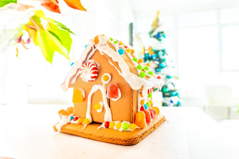 Cute, child-made gingerbread house, with imperfections a real gingerbread house assembly, for the Christmas holiday season, as a. Decoration. Classic holiday stock images