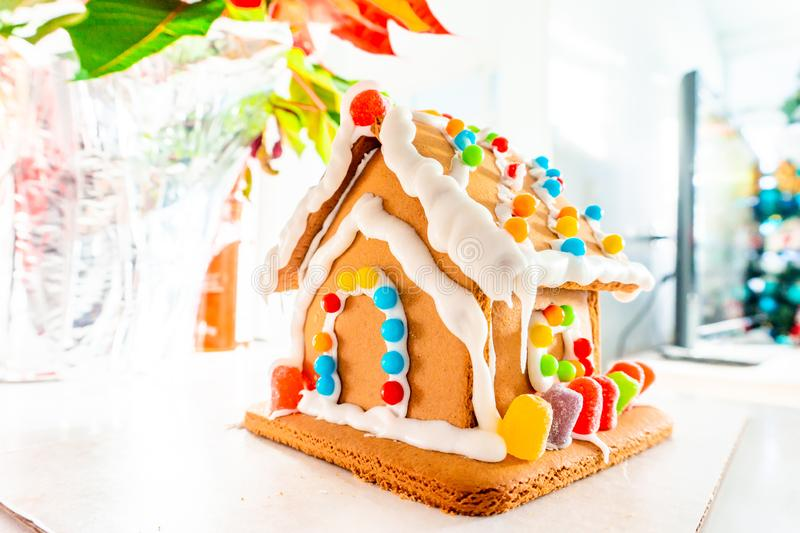 Cute, child-made gingerbread house, with imperfections a real gingerbread house assembly, for the Christmas holiday season, as a. Decoration. Classic holiday stock image