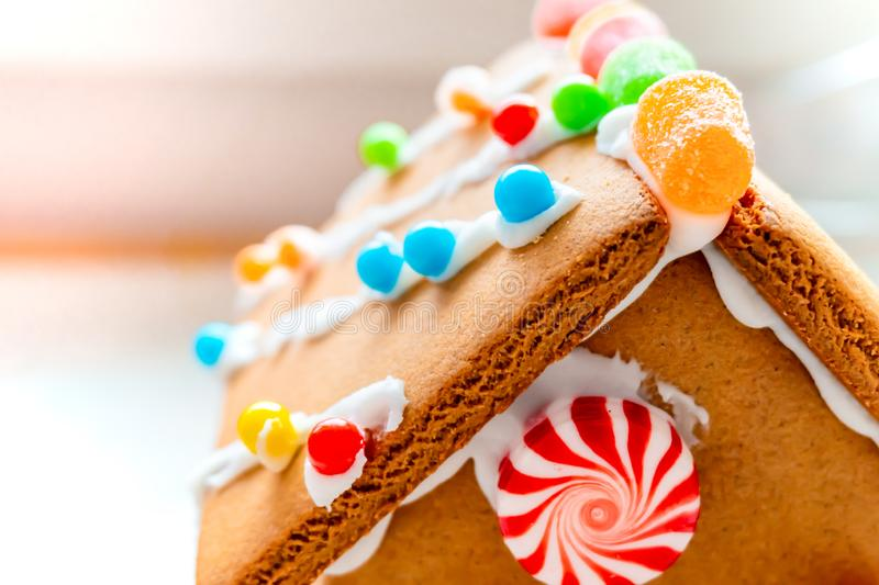 Cute, child-made gingerbread house, with imperfections a real gingerbread house assembly, for the Christmas holiday season, as a. Decoration. Classic holiday royalty free stock photos