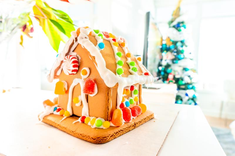 Cute, child-made gingerbread house, with imperfections a real gingerbread house assembly, for the Christmas holiday season, as a. Decoration. Classic holiday royalty free stock photography