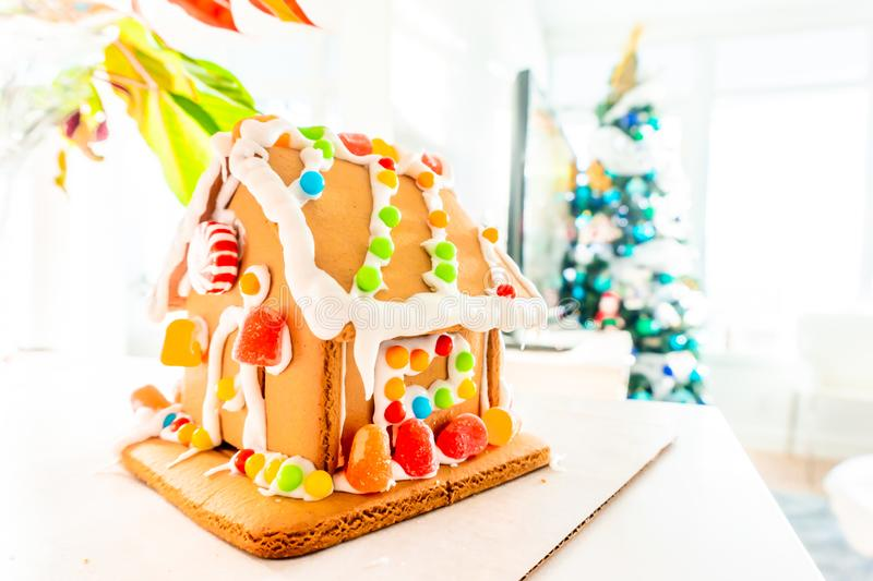 Cute, child-made gingerbread house, with imperfections a real gingerbread house assembly, for the Christmas holiday season, as a. Decoration. Classic holiday royalty free stock image